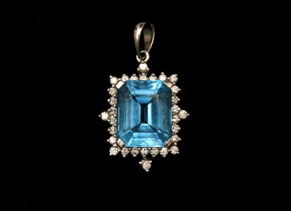 A Topaz and Diamond Pendant.
