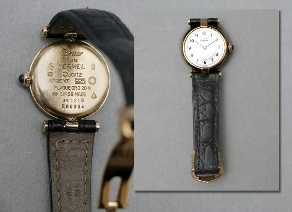 A Lady's Silver Gilt Cartier Wrist Watch.