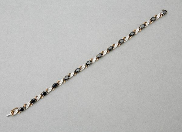 A 9ct Gold Diamond and Sapphire Bracelet.