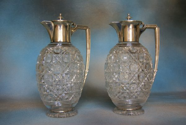 A Pair of Glass Claret Jugs.