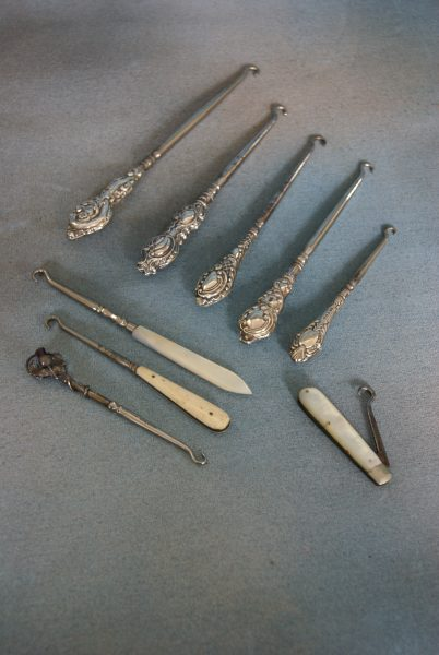 A Collection of Silver And Other Button Hooks.