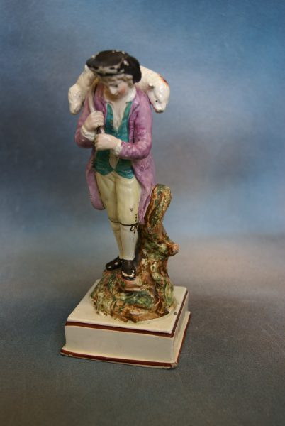 A Neale and Co Creamware Figure.
