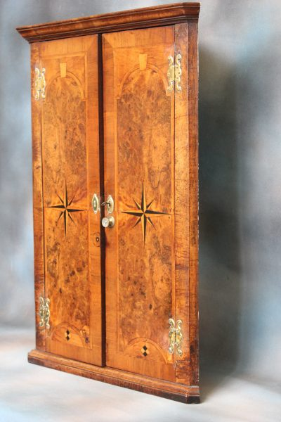 A George II Walnut Corner Cupboard.