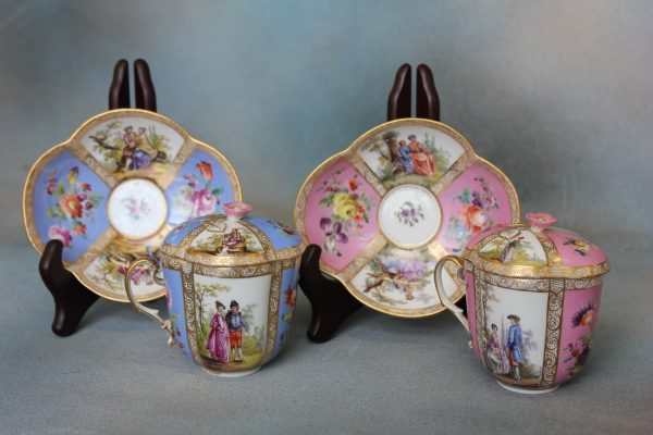A Pair of Augustus Rex Cups and Saucers.